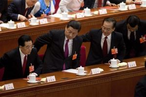 Former President Hu Jintao, President Xi Jinping, former Premier Wen Jiabao and Premier Li Keqiang stand up for the national anthem in Beijing, Sunday, March 17, 2013.