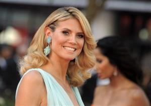 This Sept. 23, 2012 file photo shows model Heidi Klum arriving at the 64th Primetime Emmy Awards at the Nokia Theatre in Los Angeles.