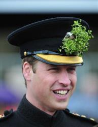 Prince William wears a shamrock during a visit with wife Kate to a St Patrick's Day Parade at Mons Barracks in Aldershot, England, Sunday, March 17, 2013.