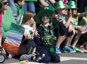 Rory Zampese, center, 5, watches the annual St. Patrick's Day Parade in Boston, Sunday, March 18, 2012.