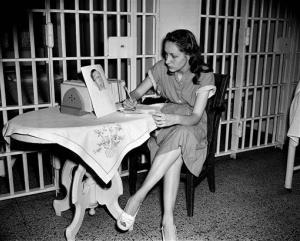 In this June 18, 1949 file photo, Ruth Steinhagen, 19, writes notes for her life history in Cook County Jail in Chicago.