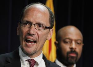 In this May 10, 2012 file photo, United States Assistant Attorney General Thomas Perez announces a federal civil lawsuit against Maricopa County Sheriff Joe Arpaio during a news conference in Phoenix.