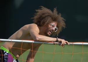 Redfoo, left, from the group LMFAO, takes a breather while playing soccer with Novak Djokovic, of Serbia, at the BNP Paribas Open tennis tournament, Saturday, March 9, 2013, in Indian Wells, Calif.