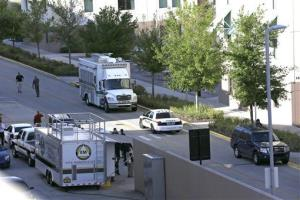Various police agencies are seen during an investigation at the University of Central Florida, Monday, March 18, 2013, in Orlando, Fla.