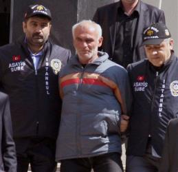 Police officers escort a Turkish man identified only as Ziya T., suspected of killing New York City woman Sarai Sierra, outside a security office in Istanbul, Turkey, Monday, March 18, 2013.