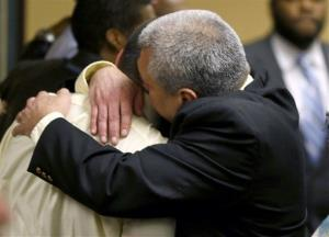 Trent Mays, 17, left, gets a hug from his father, Brian Mays, after Trent and co-defendant Ma'Lik Richmond, 16, were found delinquent on rape and other charges, Sunday, March 17, 2013.
