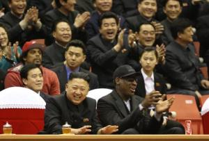 In this Feb. 28, 2013 file photo, North Korean leader Kim Jong Un, left, and Dennis Rodman watch North Korean and US players in an exhibition basketball game at an arena in Pyongyang, North Korea.