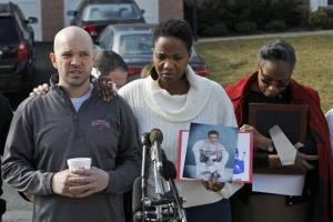 Shawn Gordley, left, and Jennea Gordley, center, parents of Caleb Gordley, talk to members of the media outside their home in Sterling, Va., Tuesday, March 19, 2013.