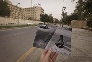 This March 12, 2013 photo shows Abu Nawas Street in Baghdad,at the site of a photograph of Iraqi orphan Fady al-Sadik waking on the street, taken by photographer Maya Alleruzzo in April, 2003.