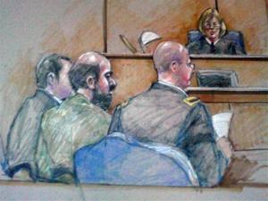 In this courtroom sketch, US Army Maj. Nidal Hasan, center foreground, is seen sitting between members of his defense team during a hearing in Fort Hood, Texas, Dec. 18, 2012.