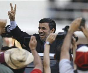 Iran's President Mahmoud Ahmadinejad makes a victory sign after attending the funeral ceremony for Hugo Chavez at the military academy in Caracas, Venezuela, March 8, 2013.