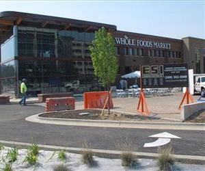 In a photo made Wednesday Aug. 29, 2012, construction workers finish the parking lot of the soon-to-open Whole Foods Market in Boise, Idaho.