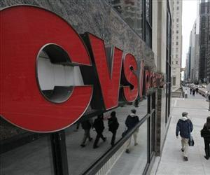 In this Feb 7, 2012 file photo, pedestrians walk pass a CVS store in Chicago.