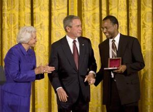 In this 2008 photo, President Bush presents medals to Dr. Benjamin Carson and retired Supreme Court Justice Sandra Day O'Connor.