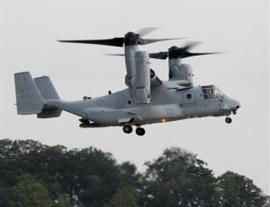 In this Aug. 3, 2012 file photo, Japan's defense minister views the MV-22B Osprey tiltrotor aircraft at the Marine Corps Base in Quantico, Va.