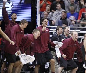 Harvard players celebrate on the bench after beating New Mexico Thursday, March 21, 2013.