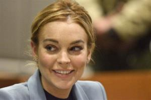 Lindsay Lohan smiles in court during a progress report on her probation for theft charges at Los Angeles Superior Court Thursday, March 29, 2012.