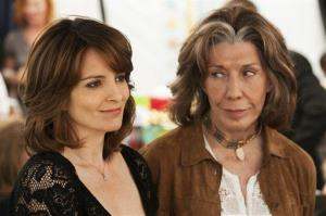 This publicity photo released by Focus Features shows Tina Fey and Lily Tomlin in a scene from 'Admission.'