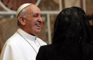 Pope Francis smiles during an audience with ambassadors from the 180 countries that have diplomatic relations with the Holy See, at the Vatican, Friday, March 22, 2013.