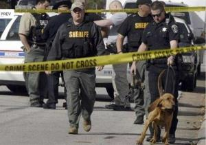 Authorities investigate the scene of shooting in Brunswick, Ga. on Thursday, March 21, 2013.