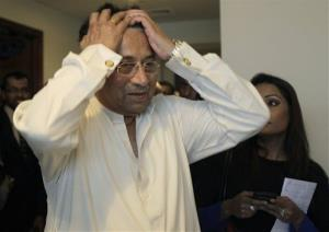 Former Pakistani President Pervez Musharraf reacts while arriving at his office for a press briefing before leaving for Karachi in Dubai, United Arab Emirates, Sunday, March 24, 2013.