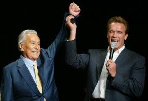This Oct. 25, 2003 file photo shows then California Gov. Arnold Schwarzenegger, right, raising the arm of Joe Weider, the creator of Mr. Olympia Bodybuilding competition, in Las Vegas.