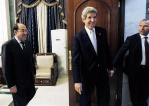US Secretary of State John Kerry leaves after meeting with Iraq's Prime Minister Nouri al-Maliki, left, in Baghdad, Iraq, Sunday, March 24, 2013.