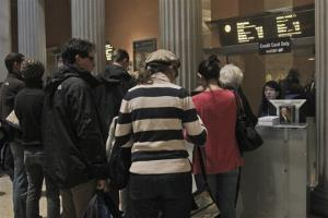 In this Tuesday, March 19, 2013 photo visitors to the Metropolitan Museum of Art in New York wait in line to buy admission tickets.