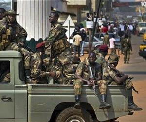 In this Jan. 5, 2013 file photo, government security forces drive past a demonstration calling for peace as negotiators prepare for talks with rebels, in Bangui, Central African Republic.