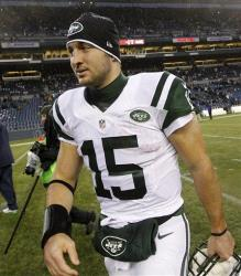 New York Jets quarterback Tim Tebow heads off the field after the Jets lost to the Seattle Seahawks in an NFL football game, Sunday, Nov. 11, 2012, in Seattle.