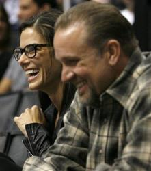 Sandra Bullock and her then-husband Jesse James attend the NHL hockey game between the Los Angeles Kings and the Phoenix Coyotes at the Staples Center, Saturday, Oct. 3, 2009, in Los Angeles.