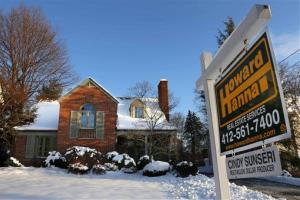 In this Thursday, Jan. 3, 2013, photo, a home is for sale in Mount Lebanon, Pa.