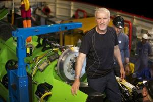 This February 2012 file photo shows James Cameron emerging from the hatch of Deepsea Challenger during testing of the submersible in Jervis Bay, south of Sydney, Australia.