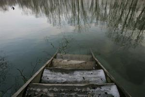 A set of steps from a fishing dock leads into the polluted Flack Rock River in Columbus, Ind.