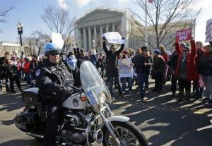 Demonstrators stand outside the Supreme Court this week.