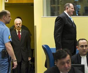 Mico Stanisic and Stojan Zupljanin enter the courtroom prior to their judgment at the Yugoslav war crimes tribunal in The Hague, Netherlands, March 27, 2013.
