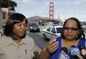 Toll takers Dawnette Reed, left, and Jacquie Dean, right, talk with reporters about their last day on the job at the Golden Gate Bridge Tuesday.