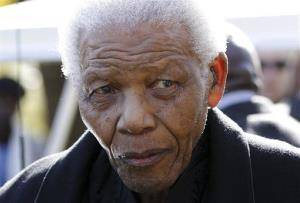 In this June 17, 2010 file photo, former South African President Nelson Mandela leaves the chapel after attending the funeral of his great-granddaughter Zenani Mandela in Johannesburg, South Africa.