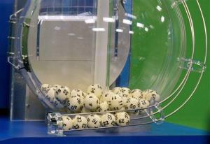 Powerball numbers are chosen in the drawing at the Florida Lottery on Wednesday, Nov. 28, 2012, in Tallahassee, Fla.