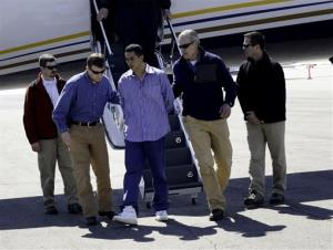 "In this photo provided by the FBI Denver Special Agents escort Rivera Gracias, one of the FBI's ""Ten Most Wanted Fugitives, off a plane, Wednesday, March 27, 2013 in Denver."