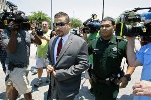 Robert Zimmerman Jr., center, brother of George Zimmerman leaves the Seminole County  Criminal Justice Center after a bond hearing, June 29, 2012, in Sanford, Fla.