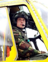 In this March 31, 2011 file photo, Britain's Prince William, the Duke of Cambridge and a Royal Air Force helicopter pilot, sits at the controls of a Sea King helicopter.