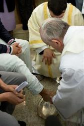 Pope Francis washes the foot of an inmate at the juvenile detention center of Casal del Marmo, Rome, Thursday, March 28, 2013.