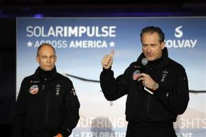 Bertrand Piccard, left, Solar Impulse Initiator, Chairman and Pilot and Andr? Borschberg, right, Solar Impulse Co-Founder, CEO and Pilot, at a press conference at Moffett Airfield,  in Mountain View, Calif., yesterday.