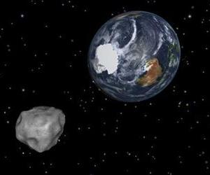 An asteroid is depicted approaching the Earth in this file image from NASA.