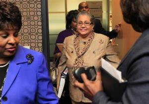 In this 2011 file photo, outgoing schools superintendent Dr. Beverly Hall, center, arrives for her last school board meeting in Atlanta.