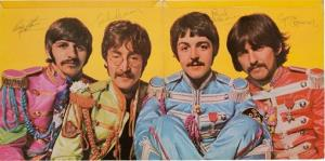 A copy of The Beatles' Sgt. Pepper's Lonely Hearts Club Band autographed by all four band members.