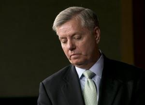 Sen. Lindsey Graham pauses during a news conference in Washington, Thursday, March 7, 2013.