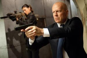 Adrianne Palicki, left, and Bruce Willis in a scene from G.I. Joe: Retaliation.