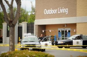 Police cars maintain a perimeter around a San Jose, Calif., Walmart after a motorist drove through a store entrance and began assaulting shoppers yesterday.